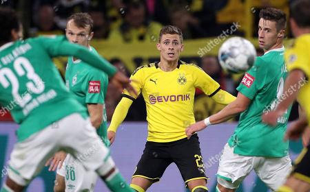 Dortmund's Thorgan Hazard (C) in action during the German Bundesliga soccer match between Borussia Dortmund and SV Werder Bremen in Dortmund, Germany, 28 September 2019.