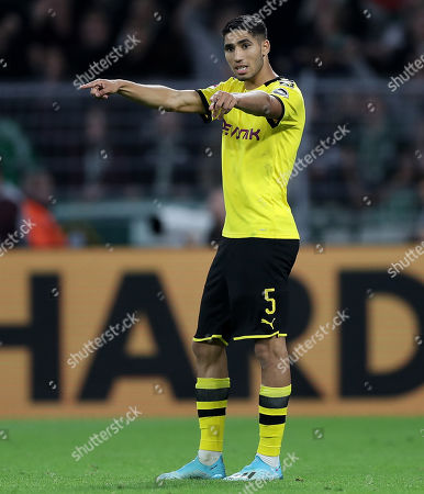 Dortmund's Achraf Hakimi gives advise during the German Bundesliga soccer match between Borussia Dortmund and SV Werder Bremen in Dortmund, Germany, 28 September 2019.