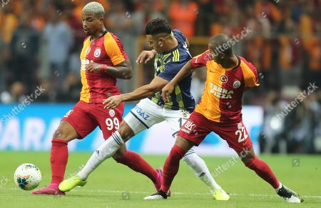 Galatasaray's Mario Lemina (L) and Mariano (R) in action against Fenerbahce's Nabil Dirar (C) during the Turkish Super League derby match between Galatasaray and Fenerbahce in Istanbul, Turkey, 28 September 2019.