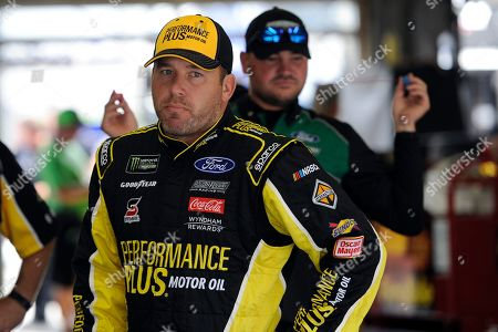Ryan Newman waits during practice for Sunday's NASCAR Cup Series auto race at Charlotte Motor Speedway in Concord, N.C