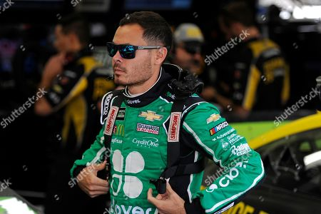 Kyle Larson waits in the garage during practice for Sunday's NASCAR Cup Series auto race at Charlotte Motor Speedway in Concord, N.C