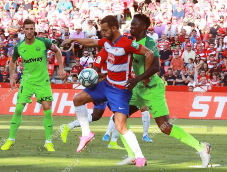 Granada CF's striker Roberto Soldado (C) duels for the ball with CD Leganes' Nigerian Kenneth Omeruo (R) during their LaLiga Primera Division soccer match played at the Nuevo Los Carmenes stadium, in Granada, Spain, 28 September 2019.