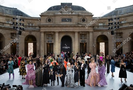 (Front, L-R) Indian actess Aishwarya Rai, a model, US actress Andie MacDowell, US actress Eva Longoria and her son Santiago, British singer Cheryl, Cuban-American singer Camila Cabello, British actress Helen Mirren, British singer Geri Halliwell, US Amber Heard and Dutch model Doutzen Kroes on the catwalk at the end of the L'Oreal fashion show during the Paris Fashion Week, in Paris, France, 28 September 2019. The presentation of the Spring/Summer 2020 collections runs from 23 September to 01 October 2019.