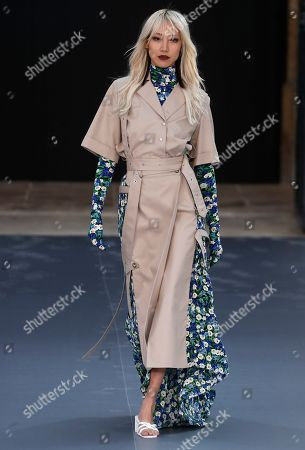 Korean model Soo Joo Park presents a creation during the L'Oreal fashion show at the Paris Fashion Week, in Paris, France, 28 September 2019. The presentation of the Spring/Summer 2020 collections runs from 23 September to 01 October 2019.