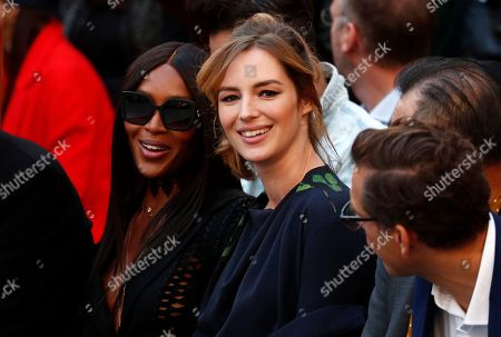 British model Naomi Campbell (L) and French actress Louise Bourgoin (R) attend the L'Oreal fashion show at the Paris Fashion Week, in Paris, France, 28 September 2019. The presentation of the Spring/Summer 2020 collections runs from 23 September to 01 October 2019.