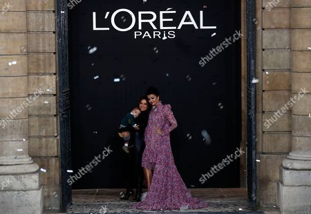 US actress Eva Longoria (C) with her son Santiago (L) and Indian actess Aishwarya Rai (R) on the catwalk at the end of the L'Oreal fashion show at the Paris Fashion Week, in Paris, France, 28 September 2019. The presentation of the Spring/Summer 2020 collections runs from 23 September to 01 October 2019.
