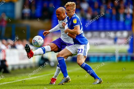 Flynn Downes of Ipswich Town Jake Caprice of Tranmere Rovers battles for possession