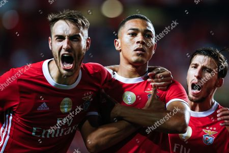 Benfica player Carlos Vinicius (C) is celebrated by teammates Ferro (L) and Ruben Dias after scoring during the Portuguese first division match between Benfica and Vitoria de Setubal at Luz stadium in Lisbon, Portugal, 28 September 2019.