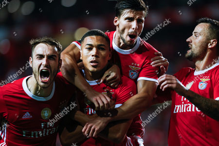 Benfica player Carlos Vinicius (2L) is celebrated by teammates Ferro (L), Ruben Dias and Haris Seferovic (R) after scoring during the Portuguese first division match between Benfica and Vitoria de Setubal at Luz stadium in Lisbon, Portugal, 28 September 2019.