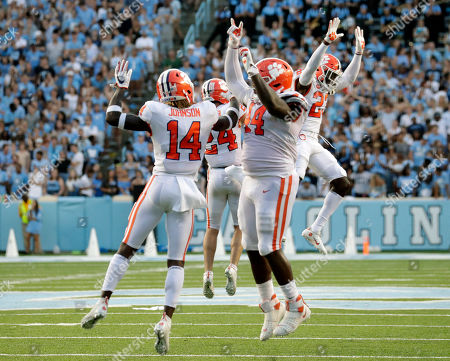 Clemson's Denzel Johnson (14), Nyles Pinckney (44), Nolan Turner (24) and Andrew Booth Jr. (23) celebrate after they stopped North Carolina on a two-point conversion in the closing moments of an NCAA college football game in Chapel Hill, N.C