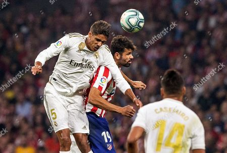 Real Madrid's French Raphael Varane (L) beats Atletico Madrid's Diego Costa to the header during the LaLiga match between Atletico Madrid and Real Madrid at the Wanda Metropolitano stadium, in Madrid, Spain, 28 September 2019.