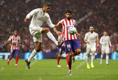 Real Madrid's Raphael Varane (L) in action against Atletico Madrid's Diego Costa during the LaLiga match between Atletico Madrid and Real Madrid at the Wanda Metropolitano stadium, in Madrid, Spain, 28 September.