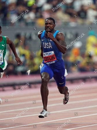 Yohan Blake of Jamaica and Justin Gatlin of United States competing in the 100 meter for men during the 17th IAAF World Athletics Championships at the Khalifa Stadium in Doha, Qatar