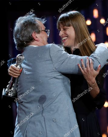 Stock Image of Alice Winocour (R) receives the Special Jury Award for 'Proxima' from Irish director Neil Jordan (L) during the closing ceremony of the 67th San Sebastian International Film Festival (SSIFF), in San Sebastian, Spain, 28 September 2019. The festival runs from 20 to 28 September.