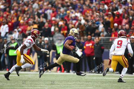 Washington Huskies tight end Hunter Bryant (1) runs after a catch and is pursued by Southern California Trojans defensive back Greg Johnson (9) and Southern California Trojans linebacker John Houston Jr (10) during a game between the Southern California Trojans and Washington Huskies at Alaska Airlines Field at Husky Stadium in Seattle, WA