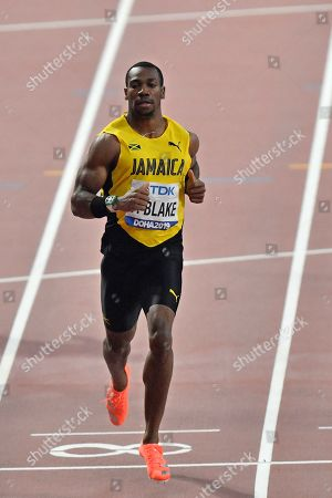 Yohan Blake, of Jamaica, competes in the men's 200 meter heats during the World Athletics Championships in Doha, Qatar