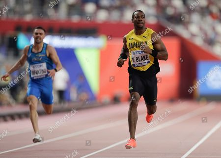 Yohan Blake, of Jamaica races in the men's 200 meter heats at the World Athletics Championships in Doha, Qatar