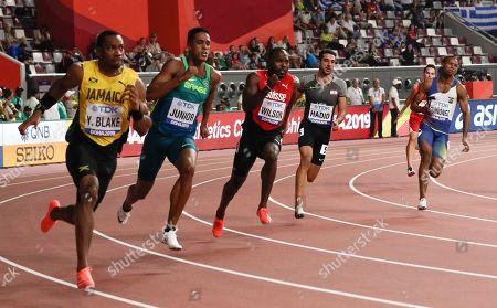 Yohan Blake, of Jamaica, Aldemir Junior, of Brazil, Alex Wilson, of Switzerland, Noureddine Hadid, of Lebanon and Alex Qui?ez, of Ecuador race in the men's 200 meter heats at the World Athletics Championships in Doha, Qatar