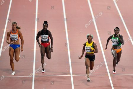 Dafne Schippers, of the Netherlands, Kelly-Ann Baptiste, of Trinidad And Tobago, Shelly-Ann Fraser-Pryce, of Jamaica, and Murielle Ahouré, of The Ivory Coast, from left to right, compete in the women's 100 meter semifinal during the World Athletics Championships in Doha, Qatar