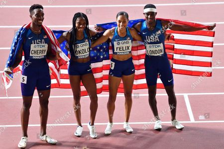 Michael Cherry, Courtney Okolo Allyson Felix and Wilbert London, of the United States, pose after winning the gold medal in the mixed 4x400 meter relay race during the World Athletics Championships in Doha, Qatar