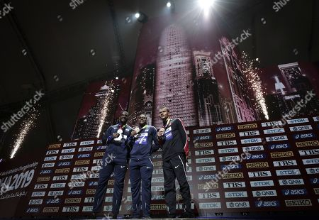 Christian Coleman of the United States, gold, Justin Gatlin of the United States, silver, and Andre De Grasse of Canada, bronze, pose during the medal ceremony for the men's 100m at the World Athletics Championships in Doha, Qatar