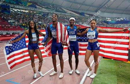 The United States team of Allyson Felix, Wilbert London, Michael Cherry and Courtney Okolo pose after winning the gold medal in the mixed 4x400 meter relay race at the World Athletics Championships in Doha, Qatar