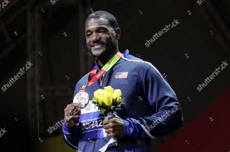 Justin Gatlin of the United States, silver winner, smiles during the medal ceremony for the men's 100m at the World Athletics Championships in Doha, Qatar