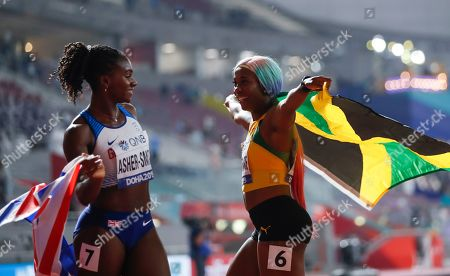 Shelly-Ann Fraser-Pryce, of Jamaica wins the gold medal in the women's 100 meter final ahead of Dina Asher-Smith, of Great Britain, silver, at the World Athletics Championships in Doha, Qatar