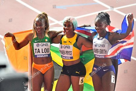 Bronze medalist Marie-Josée Ta Lou, of The Ivory Coast, gold medalist Shelly-Ann Fraser-Pryce, of Jamaica, and Silver medalist Dina Asher-Smith, of Great Britain, from left to right, pose after the women's 100 meter final during the World Athletics Championships in Doha, Qatar