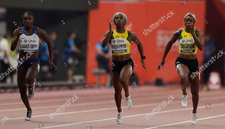 Shelly-Ann Fraser-Pryce, of Jamaica, center, races to win the gold medal in the women's 100 meter final ahead of Dina Asher-Smith, of Great Britain, silver, at the World Athletics Championships in Doha, Qatar