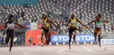 Shelly-Ann Fraser-Pryce, of Jamaica, second left, wins the gold medal in the women's 100 meter final ahead of Dina Asher-Smith, of Great Britain, left, silver, and Marie-Josée Ta Lou, of The Ivory Coast, right, bronze, at the World Athletics Championships in Doha, Qatar