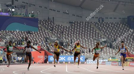 Shelly-Ann Fraser-Pryce, of Jamaica, third left, wins the gold medal in the women's 100 meter final ahead of Dina Asher-Smith, of Great Britain, second left, silver, and Marie-Josée Ta Lou, of The Ivory Coast, second right, bronze, at the World Athletics Championships in Doha, Qatar