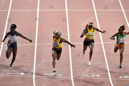 Silver medalist Dina Asher-Smith, of Great Britain, gold medalist Shelly-Ann Fraser-Pryce, of Jamaica, fourth placed Elaine Thompson, of Jamaica, and bronze medalist Marie-Josée Ta Lou, of The Ivory Coast, from left to right, compete in the women's 100 meter final during the World Athletics Championships in Doha, Qatar