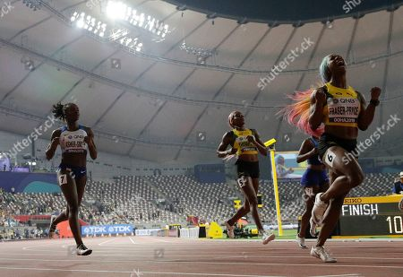 Shelly-Ann Fraser-Pryce, of Jamaica, right, wins the gold medal in the women's 100 meter final ahead of Dina Asher-Smith, of Great Britain, left, silver, at the World Athletics Championships in Doha, Qatar