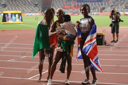Shelly-Ann Fraser-Pryce, of Jamaica, center, with son Zyon wins the gold medal in the women's 100 meter final ahead of Dina Asher-Smith, of Great Britain, right, silver, and Murielle Ahouré, of The Ivory Coast, bronze, at the World Athletics Championships in Doha, Qatar