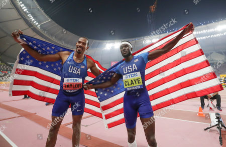 Christian Taylor, left, of the United States, and Will Claye, of the United States, pose together after the men's triple jump final at the World Athletics Championships in Doha, Qatar, . Taylor won the gold medal and Claye won the silver