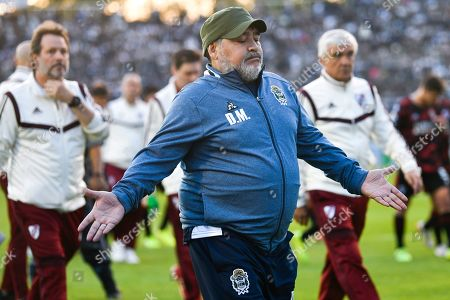 Diego Maradona, coach of La Plata's soccer team, shows his discontent at half time of a local tournament match against River Plate, at the Juan Carmelo Zerillo Stadium in La Plata, Argentina