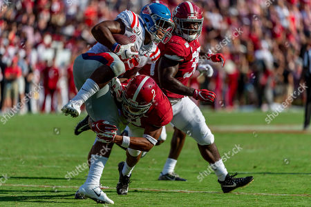 Alabama defensive back Patrick Surtain II (2) tackles Mississippi running back Scottie Phillips (22) during the first half of an NCAA college football game, in Tuscaloosa, Ala
