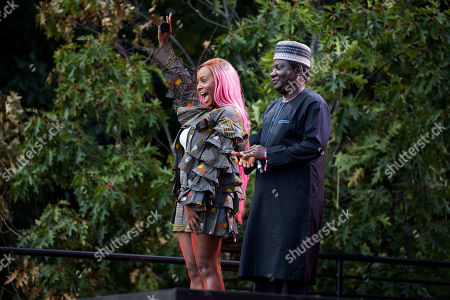 Florence Otedola waves at the crowd alongside Simon Bako Lalong, governor of Plateau State in Nigeria, at the 2019 Global Citizen Festival, in New York
