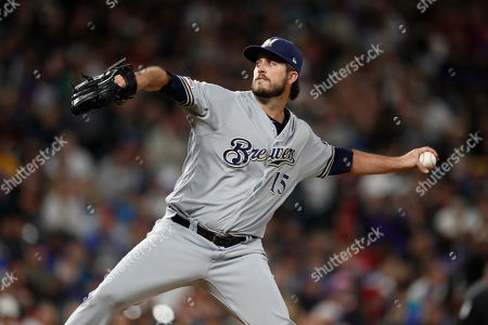 R m. Milwaukee Brewers starting pitcher Drew Pomeranz works against Colorado Rockies' Charlie Blackmon in the seventh inning of a baseball game, in Denver