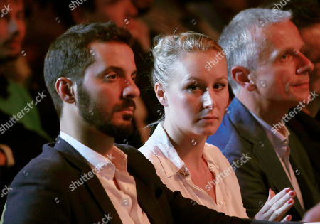 """Italian politician Vincenzo Sofo, left, sits next to his companion Marion Marechal, niece of far-right leader Marine Le Pen during the Convention of the Right, in Paris, . The Convention of the Right, a first ever gathering of rebel representatives of the mainstream right and the far right. Among their goals is to defeat the """"progressives"""" of centrist President Emmanuel Macron"""