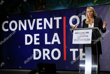 """Marion Marechal, niece of far-right leader Marine Le Pen gestures as she speaks at the Convention of the Right, in Paris, . The Convention of the Right, a first ever gathering of rebel representatives of the mainstream right and the far right. Among their goals is to defeat the """"progressives"""" of centrist President Emmanuel Macron"""