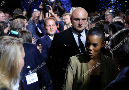"""Candace Owens, director of urban engagement for Turning Point USA, right, looks at Marion Marechal, niece of far-right leader Marine Le Pen, left, as she arrives at the Convention of the Right, in Paris, . The Convention of the Right, a first ever gathering of rebel representatives of the mainstream right and the far right. Among their goals is to defeat the """"progressives"""" of centrist President Emmanuel Macron"""