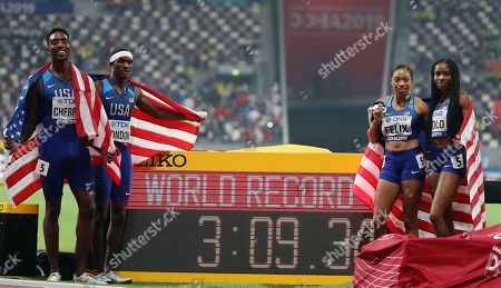 US relay team members (L-R) Michael Cherry, Wilbert London, Allyson Felix, and Courtney Okolo pose after setting a new World Record time to win the 4x400m Mixed Relay final at the IAAF World Athletics Championships 2019 at the Khalifa Stadium in Doha, Qatar, 29 September 2019.