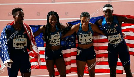 US relay team members (L-R) Michael Cherry, Courtney Okolo, Allyson Felix, and Wilbert London pose after setting a new World Record time to win the 4x400m Mixed Relay final at the IAAF World Athletics Championships 2019 at the Khalifa Stadium in Doha, Qatar, 29 September 2019.