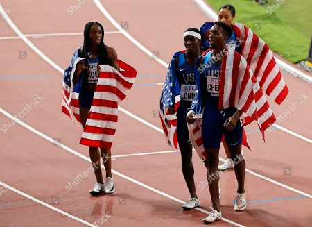 US relay team members (L-R) Courtney Okolo, Wilbert London, Michael Cherry, and Allyson Felix (react) after setting a new World Record time to win the 4x400m Mixed Relay final at the IAAF World Athletics Championships 2019 at the Khalifa Stadium in Doha, Qatar, 29 September 2019.