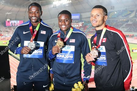 Gold medalist Christian Coleman (C) of the USA, silver medalist Justin Gatlin (L) of the USA and bronze medalist Andre de Grasse of Canada during the award ceremony of the men's 100m competition of the IAAF World Athletics Championships 2019 at the Khalifa Stadium in Doha, Qatar, 29 September 2019.