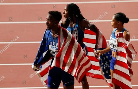 US relay team members (L-R) Michael Cherry, Courtney Okolo, and Allyson Felix react after setting a new World Record time to win the 4x400m Mixed Relay final at the IAAF World Athletics Championships 2019 at the Khalifa Stadium in Doha, Qatar, 29 September 2019.