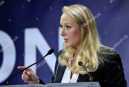 """Marion Marechal, niece of far-right leader Marine Le Pen speaks at the Convention of the Right, in Paris, . The Convention of the Right, a first ever gathering of rebel representatives of the mainstream right and the far right. Among their goals is to defeat the """"progressives"""" of centrist President Emmanuel Macron"""