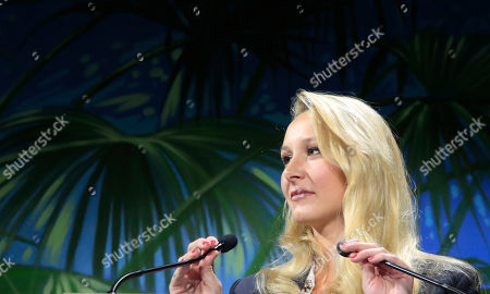 """Stock Image of Marion Marechal, niece of far-right leader Marine Le Pen adjusts the microphone as she speaks at the Convention of the Right, in Paris, . The Convention of the Right, a first ever gathering of rebel representatives of the mainstream right and the far right. Among their goals is to defeat the """"progressives"""" of centrist President Emmanuel Macron"""